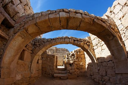 Converging ancient stone arches  photo