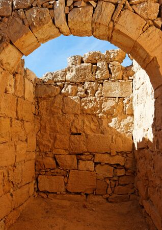 Ancient stone arch and wall at castle ruin photo