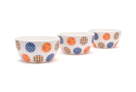 Row of porcelain bowls isolated photo