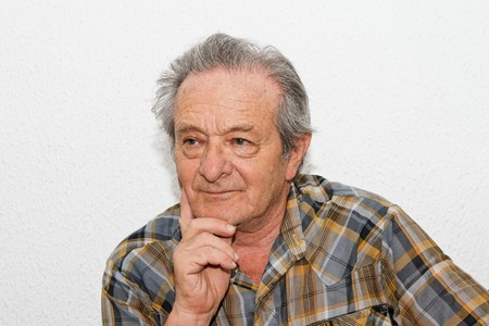 Elderly man with thoughtful expression