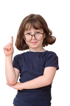 Little girl in round spectacles raising finger in attention gesture isolated Stock Photo