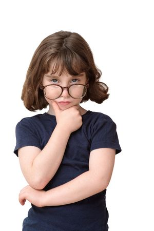 Thoughtful little girl in round spectacles rests her head on her hand isolated
