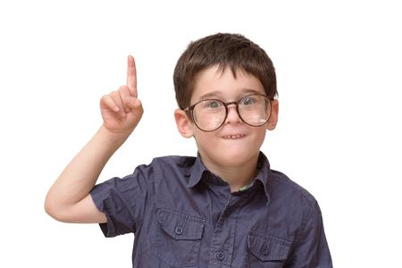 Little boy in round spectacles raising finger in funny attention gesture isolated Stock Photo - 7123617