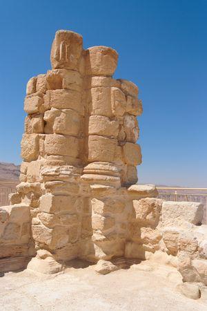 Ancient broken column of King Herod palace in Masada  photo