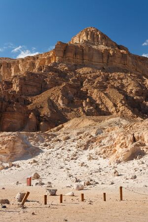timna: Weathered sandstone mountain in the desert in Timna national park in Israel