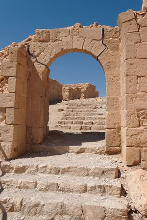 Ancient stone arch and staircase photo