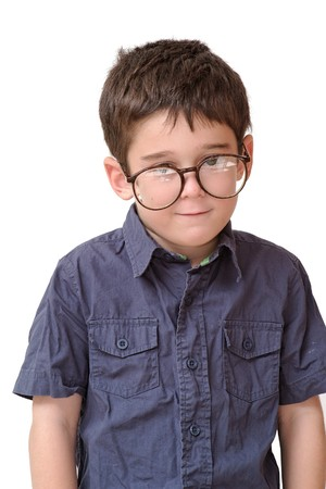Little boy in funny round spectacles stands isolated