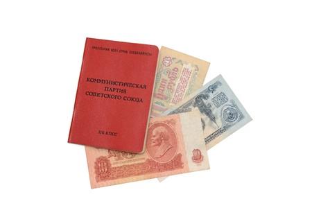 Soviet party membership card with Soviet money inside it isolated photo