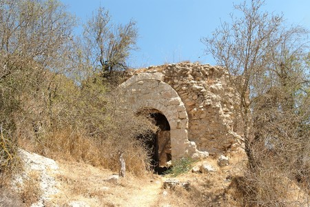 Ruin of the old stone house in Mediterranean landscape photo