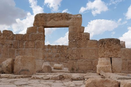 Stone entrance and wall of ruined ancient synagogue  photo