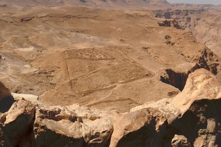 Excavations of ancient Roman camp near Masada fortress in the desert photo
