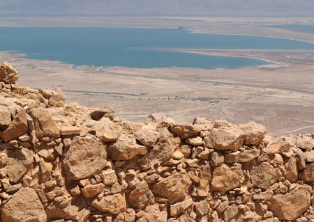 Wall of ancient fortress ruin in the desert near the Dead Sea photo