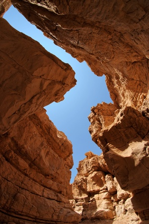 Narrow slot between two rocks in desert canyon