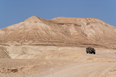 Israeli army Humvee on patrol in the Judean desert  Stock Photo