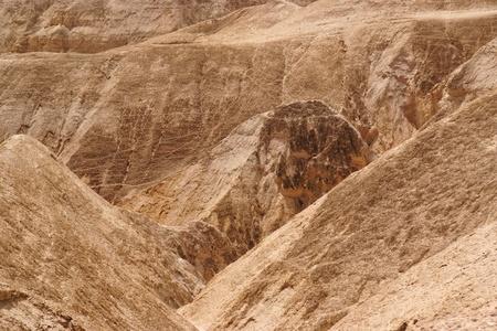 Textured orange hills in the desert  photo