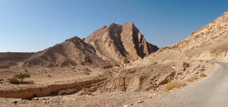 ridged: Scenic ridged brown rock at the road  in stone desert
