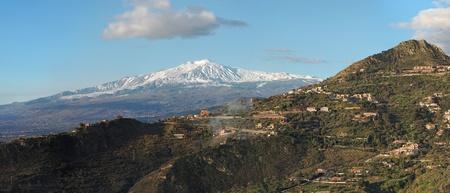 effusion: Snow peak of Etna volcano, Sicily, seen from Taormina