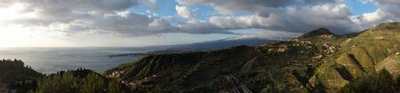 volcanic landscape: Dawn panorama of Taormina Bay and Giardini-Naxos in Sicily,Italy