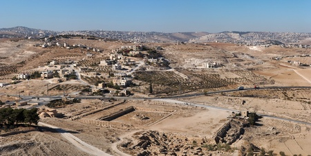 judean hills: Excavations and Arab village at the place of ancient King Herod palace in Herodion