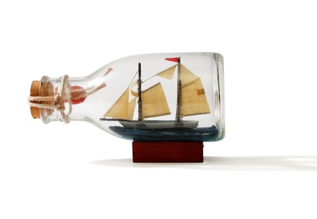 Two-masted ship in a bottle isolated on white background Stock Photo