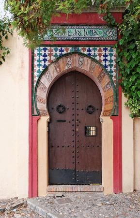Moorish style door of a house in Granada, Spain photo