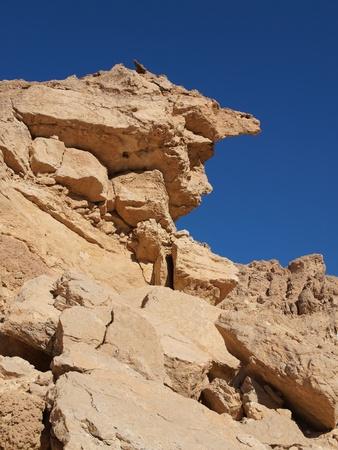 sedimentary: Scenic weathered yellow rock in stone desert