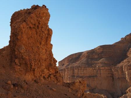 Scenic pillar rock in a stone desert at sunset photo