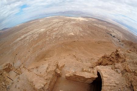 Fisheye view of desert landscape near the Dead Sea seen from ruins of Masada fortress photo