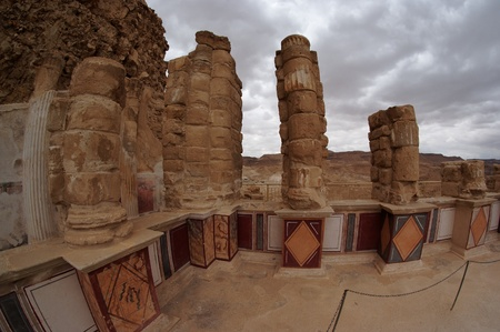 Fisheye view of colonnade of ancient Masada palace of King Herod on cloudy day photo