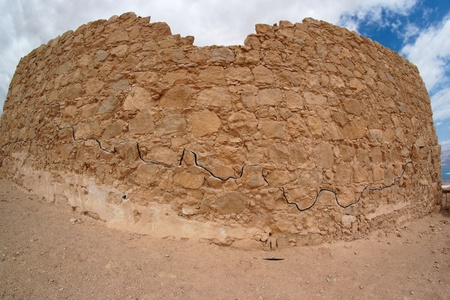 Fisheye view of ancient fortress ruin in the desert near the Dead Sea photo