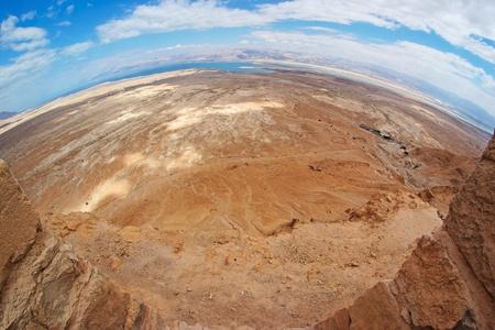 masada: Fisheye view of desert landscape near the Dead Sea seen from Masada fortress Stock Photo