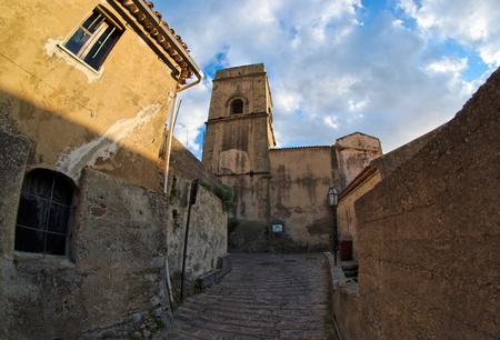 Fisheye view of medieval street in village of Savoca in Sicily, Italy, at sunset photo