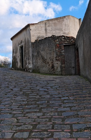 Paved medieval street in Savoca village, Sicily, Italy photo