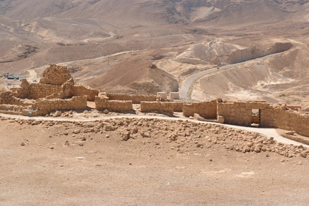 Ruins of ancient Masada fortress in the desert photo