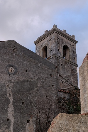 Old church belfry in Savoca village, Sicily, Italy in the evening photo