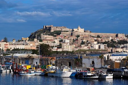 View from sea of Milazzo town in Sicily, Italy, with medieval castle on hilltop