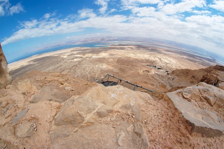 Fisheye view of desert landscape under Masada fortress near the Dead Sea photo