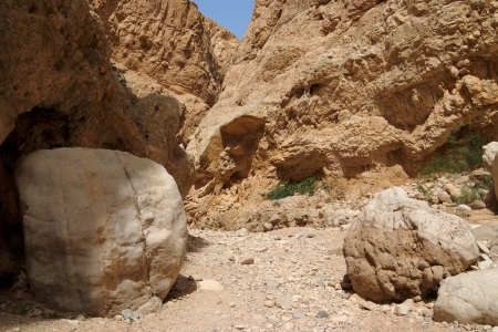 Boulders in desert canyon photo