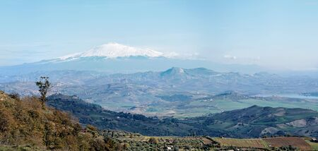 effusion: Sicilian rural landscape in winter with snow peak of Etna volcano in Italy Stock Photo