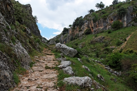Trail in gorge Mirador de Bailon near Zuheros  in Spain in cloudy day