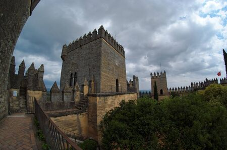 crenelation: Fisheye view of Almodovar del Rio medieval castle on a cloudy day