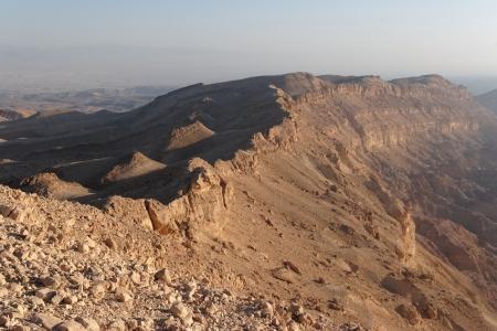 canyon negev: Rim of desert canyon at sunset  Small Crater, or Makhtesh Katan, Negev desert, Israel