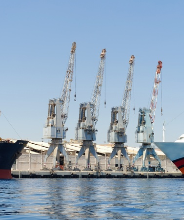 shipload: Row of four cranes in Eilat harbor, Israel Stock Photo