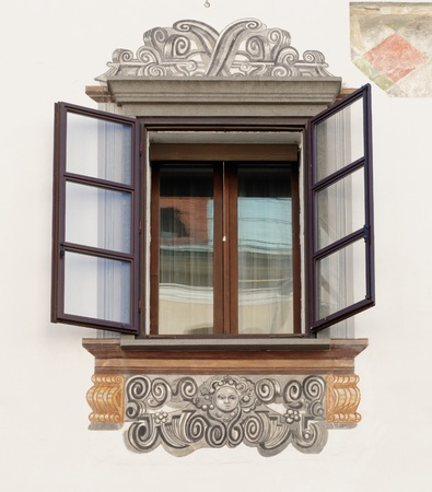 murals: Window of old house in Ljubljana, Slovenia, with murals