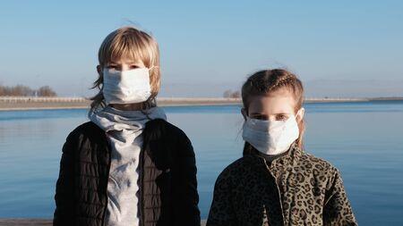 COVID-2019. Children wearing a face mask Reklamní fotografie