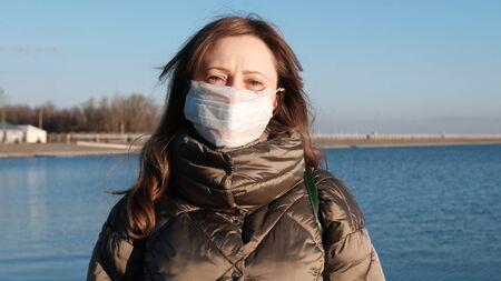 COVID-19. Yuong woman wearing a face mask