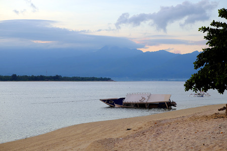 drowned: Drowned boat near gili meno, indonesia in the early morning before the sunrise