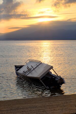 drowned: Drowned boat near gili meno, indonesia in the early morning during the sunrise Stock Photo