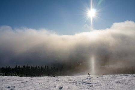 skying: Skying in the cloudy mist