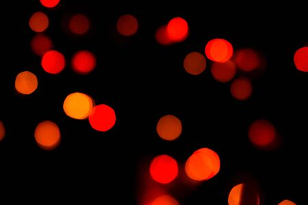 Isolated red sparkles from lights on black bacground. Archivio Fotografico - 137152785